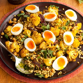 Roasted Cauliflower, Spiced Chickpea, Couscous & Egg Salad with a Zhoug Dressing
